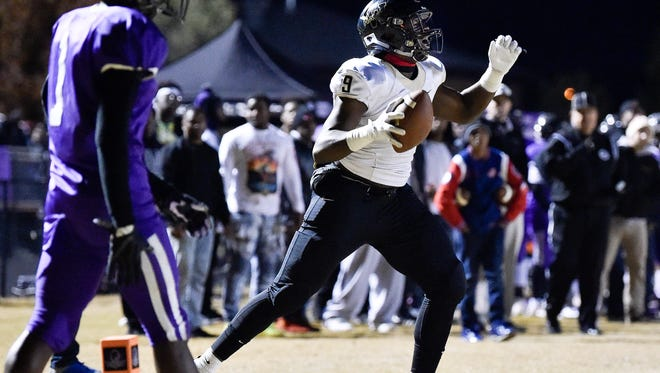 Whitehaven's Cormontae Hamilton (9) receives a pass for a touchdown against Cane Ridge during the second half of the Class 6A semifinal at Cane Ridge High School in Antioch, Tenn., Friday, Nov. 24, 2017.