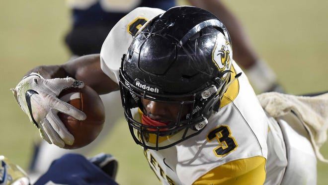 Starkville's Rodrigues Clark (3) goes over the top of the Pearl line for a touchdown on Friday, December 1, 2017, at the MHSAA Football State Championships at Vaught-Hemmingway Stadium on the University of Mississippi campus in Oxford, Miss.