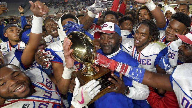 Noxubee County head coach Tyrone Shorter and the Tigers celebrate with the Class 4A trophy after beating East Central 41-35 on Saturday, December 2, 2017, at the MHSAA Football State Championships at Vaught-Hemmingway Stadium on the University of Mississippi campus in Oxford, Miss.