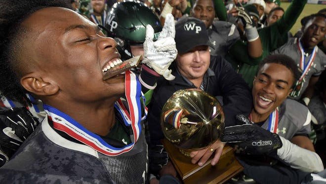 The West Point Green Wave celebrate with the Class 5A trophy after beating Hattiesburg 41-15 on Saturday, December 2, 2017, at the MHSAA Football State Championships at Vaught-Hemmingway Stadium on the University of Mississippi campus in Oxford, Miss.