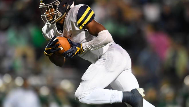 Lausanne's Eric Gray (1) runs the ball against Notre Dame during the second half of the Division II-AA state championship game at Tucker Stadium in Cookeville, Tenn., Saturday, Dec. 2, 2017.