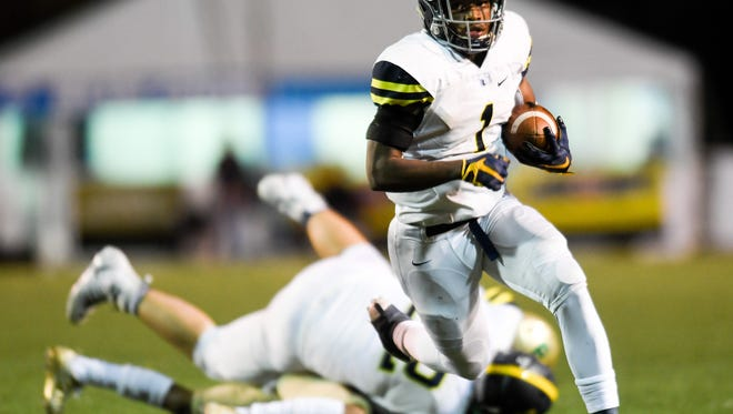 Lausanne's Eric Gray (1) runs in a touchdown against Notre Dame during the second half of the Division II-AA state championship game at Tucker Stadium in Cookeville, Tenn., Saturday, Dec. 2, 2017.
