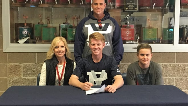 Piedra Vista baseball player Cody McGaha, bottom center, signed his national letter of intent on Thursday to continue his career at Scottsdale Community College in Scottsdale, Ariz.