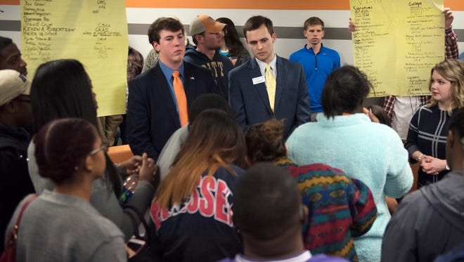 Student Government Association senate member Alex Joyner and president Jordan Long answer questions from a crowd of students gathered Friday, Dec. 1, 2017, for a sit-in in front of the Student Government Association offices at UT Martin.