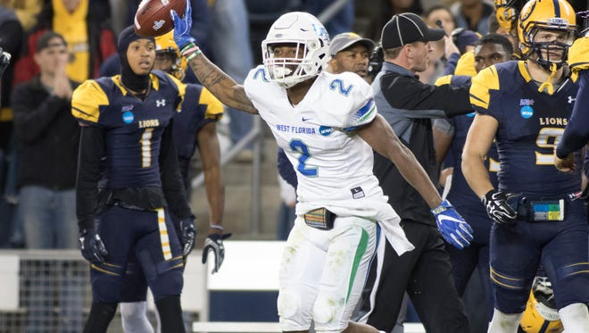 UWF linebacker Andre Duncombe Jr. celebrates after intercepting a pass against Texas A&M-Commerce in the NCAA Division II championship game on Dec. 16 in Kansas City, Kansas.