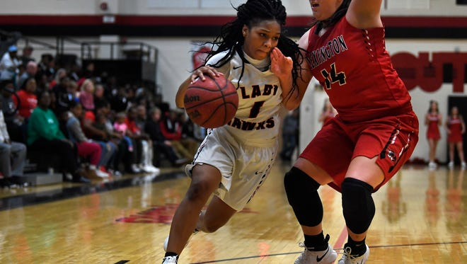South Side's Quanardra Miller dribbles the ball passed Lexington's Kaitlyn Kelley on Tuesday, Dec. 19, 2017, during South Side's 72-70 District 14-AA win over Lexington at South Side.