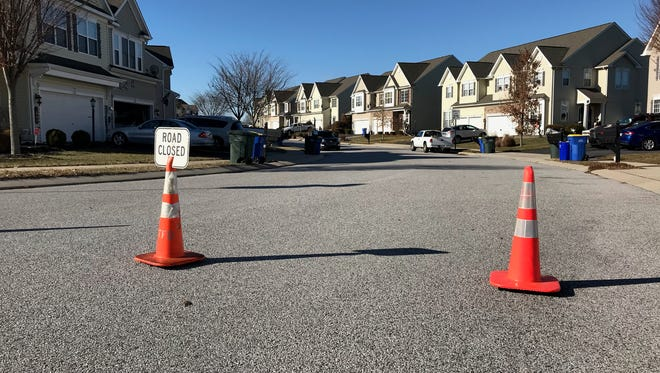 Police have closed off a portion of the street near the shooting in Dover Township.