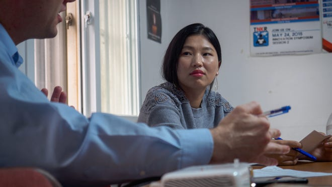 North Korean refugee Sharon Jang studies English and public speaking with instructor Tony Docan-Morgan at the non-profit group Teach North Korean Refugees in Seoul.
