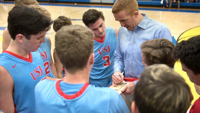 USJ Coach Oliver Simmons speaks with his team in a time out Tuesday, Jan. 9, 2018, during USJ's 40-32 victory against Jackson Christian at Jackson Christian School.