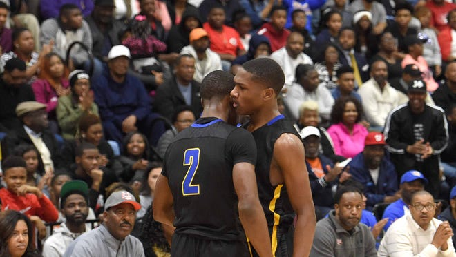 Canton's Damerius Wash (2) and Brandon Weatherspoon chest bump after play against Olive Branch during a Rumble in the South MLK Classic high school basketball tournament game on Monday, January 15, 2018, at St. Andrew's Episcopal School in Ridgeland, Miss.