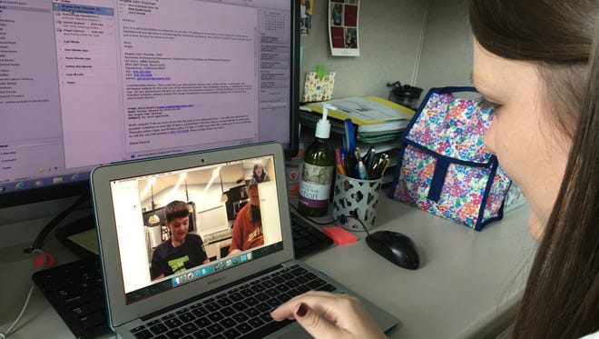 Speech language clinician Amy Banasik coaches Kristen Lundstrom over Skype in her use of strategies to help her son, Tyson expand his sentences and use new vocabulary words.