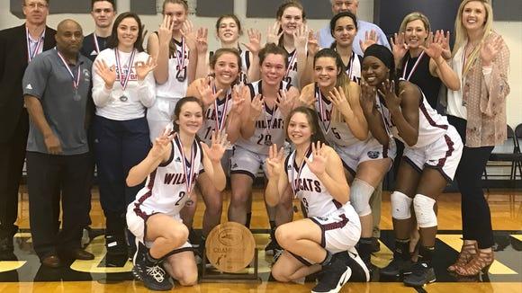 Carolina Day celebrates after winning its eighth consecutive NCISAA girls basketball championship.