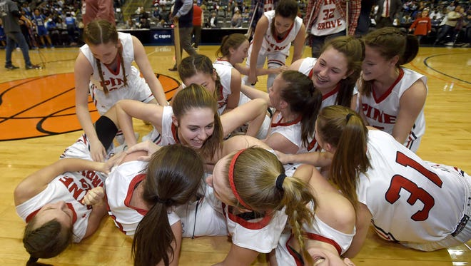 The Pine Grove Lady Panthers recover from the dog pile at center court after beating McAdams in the finals of the MHSAA C Spire State Basketball Tournament at the Mississippi Coliseum in Jackson, Miss., on Thursday, March 8, 2018.