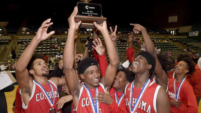 The Coahoma County Red Panthers celebrate with the Class 2A trophy after beating Bay Springs 62-46 in the finals of the MHSAA C Spire State Basketball Tournament at the Mississippi Coliseum in Jackson, Miss., on Friday, March 9, 2018.