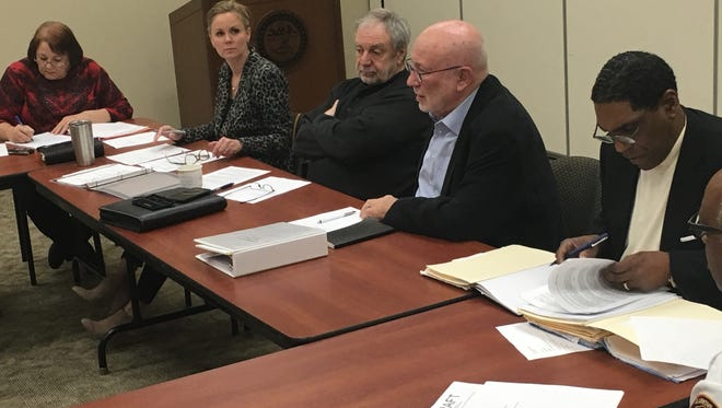 Carl Wilson, third from right, of the 15-member charter commission on proposed consolidated government, speaks Thursday as some of the other panel members listen. Shown from left are Shelly Baggett recording the minutes; Katie Gambill, who chairs the charter commission; Mark Smith; Wilson; Mark Kelly and Ray Williams.