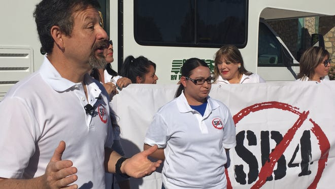 Fernando Garcia, executive director of the Border Network for Human Rights, speaks at a news conference Friday. The pro-immigrant organization launched a caravan that will travel to cities in Texas to educate the public about their constitutional rights to resist Senate Bill 4.