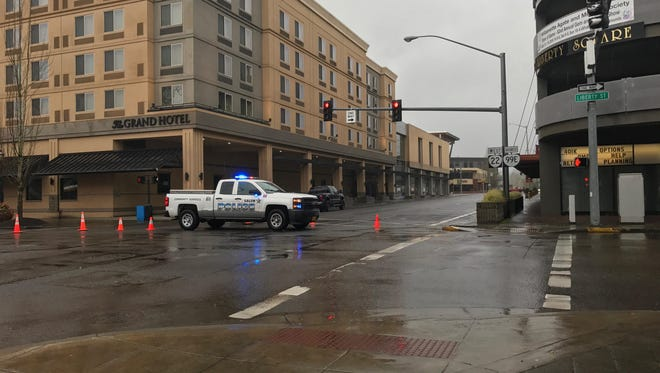 Two lanes on Ferry Street SE are closed after a pedestrian was hit by a vehicle at approximately 3:30 p.m. Saturday.