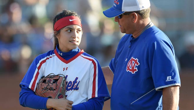 Neshoba Central head coach Trae Embry talks Tenly Grisham between innings on Tuesday, April 10, 2018, at Madison Central High School in Madison, Miss.