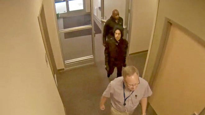 Prince, center, enters a clinic of Dr. Michael Todd Schulenberg on April 20, 2016, the day before he was found dead of an accidental fentanyl overdose. Image made from surveillance video provided by the Carver County Sheriff's Office as part of investigation into Prince's death.