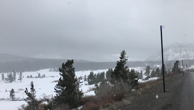 Snow falling over Mt. Rose on Sunday, April 29, 2018