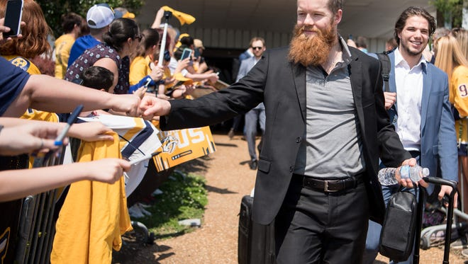 Nashville Predators defenseman Ryan Ellis (4) greets fans outside of Signature Flight Support in Nashville, Tenn., Tuesday, May 8, 2018. The Nashville Predators were greeted by dozens of fans as they arrived home from their game 6 victory in Winnipeg.