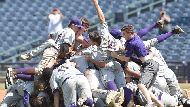 The DeSoto Central Jaguars celebrate with a dogpile after beating George County on Saturday, May 19, 2018, in the MHSAA State Baseball Championships at Trustmark Park in Pearl, Miss.