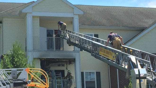 Crews battle a three-alarm fire at Willows Senior Apartments Tuesday afternoon.