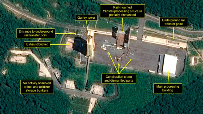 This July 22, 2018, satellite image released and annotated by 38 North on Monday, July 23, shows what the U.S. research group says is the partial dismantling of the rail-mounted transfer structure, at center, at the Sohae launch site in North Korea.