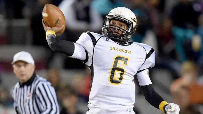 Oak Grove quarterback Cameron Myers throws deep over the middle against Brandon on Friday, November 28, 2014, in the MHSAA Class 6A south state football championship at Brandon.