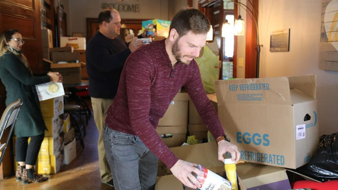 Pastor Anthony Mugnano organizes boxes of food at Encounter Church, which will be the new home of the New Windsor food pantry starting Feb. 21.