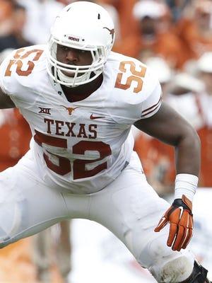 Former Texas offensive lineman Darius James is transferring to Auburn.