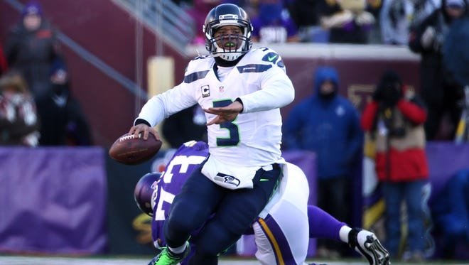 Jan. 10, 2016; Minneapolis; Seattle Seahawks quarterback Russell Wilson (3) throws a pass against the Minnesota Vikings in the third quarter of a NFC Wild Card playoff football game at TCF Bank Stadium.