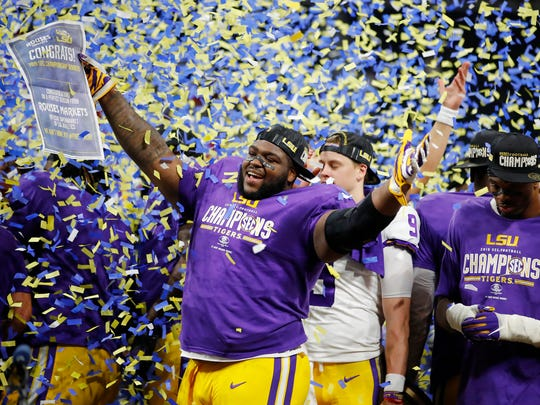 Tyler Shelvin celebrates after LSU defeated Georgia in the SEC Championship Game at Mercedes-Benz Stadium in Atlanta.