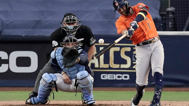 The Astros' Carlos Correa connects for a seventh-inning double Friday night against the Rays in Game 6 of the American League Chamionship Series.