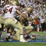 Florida State quarterback Sean Maguire (10) scrambles for yardage during the first half of Saturday's game against the Florida Gators in Gainesville.