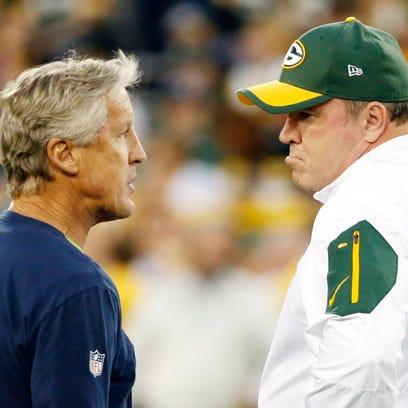 Seattle Seahawks head coach Pete Carroll, left, talks