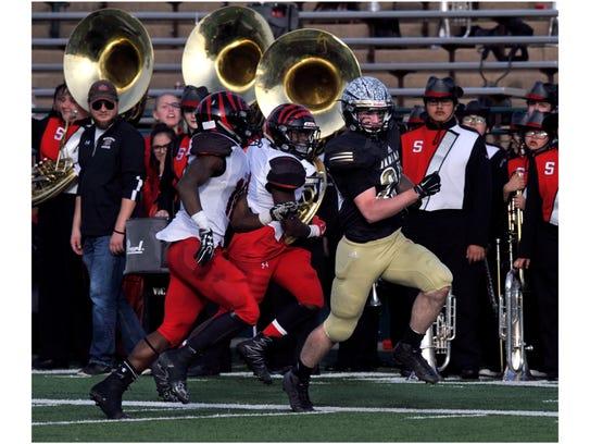 Comanche High School running back Kade Mercer carries