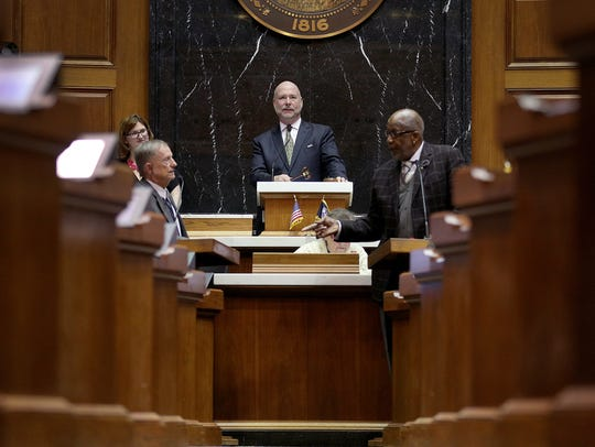 The final day of the legislative session made for busy lawmakers in the house and senate chambers Wednesday, March 14, 2018. Speaker of the house Brian Bosma watches a discussion between Rep. David Wolkins, left, and Rep. Charlie Brown on the final day of the legislative session.