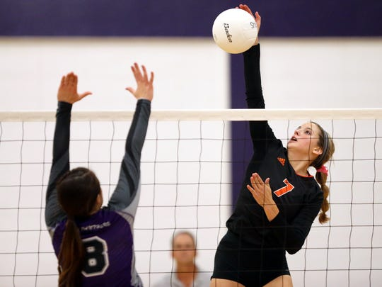 Orange Grove's Hannah Allison hits the ball over Aransas Pass' Rayghan Poimboeuf on Tuesday, Oct. 18, 2016, at Aransas Pass High School. The Bulldogs won the match in three sets.