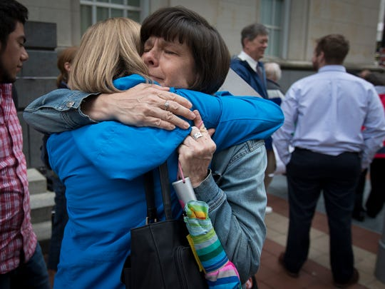 Tuesday, April 11, 2017: Outside of the 6th U.S. Circuit Court of Appeals in Cincinnati, Sister Andrea Koverman (facing), hugs Sister Tracy Kemme both of the Delhi Sisters of Charity. 