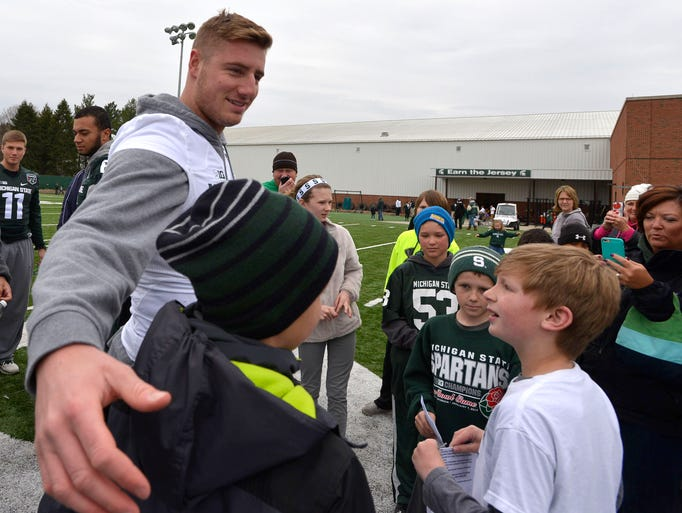 Spartan quarterback Connor Cook draws a crowd of admirers