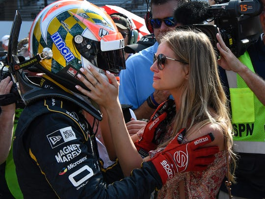 Schmidt Peterson Motorsports IndyCar driver James Hinchcliffe (5) embraces his girlfriend Becky Dalton after he failed to make the field of 33 cars on qualification day for the Indianapolis 500 at the Indianapolis Motor Speedway on Saturday, May 19, 2018.