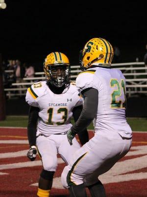 Sycamore receiver Khadim Fall (13) celebrates a touchdown with Ra'Von Bonner (21) against Lebanon.