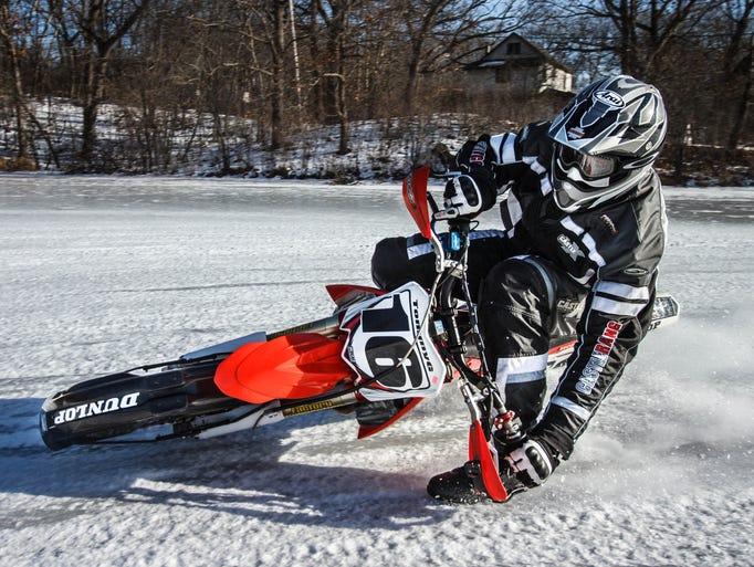 Tom Girard of Nashotah blasts through a turn on a frozen