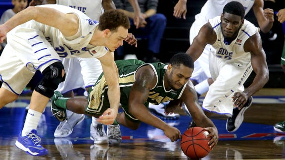 UAB's Denzell Watts tries regain control of the ball as MTSU's Reggie Upshaw Jr. and Jacquez Rozier move in to steal the ball in the second half of the game on Sunday Jan. 4, 2015.