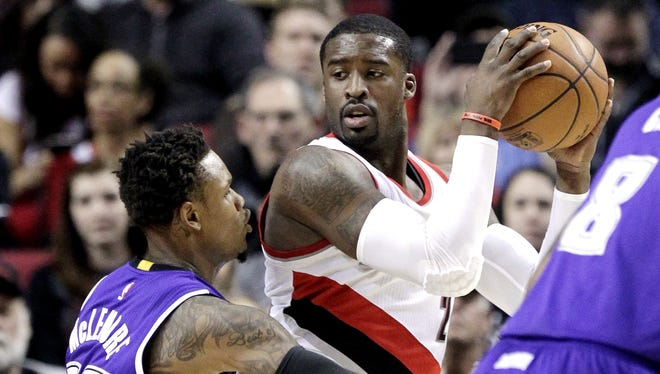 Portland Trail Blazers guard Wesley Matthews, right, looks for room to maneuver against Sacramento Kings guard Ben McLemore during the first half of an NBA basketball game in Portland, Ore., Monday, Jan. 19, 2015.