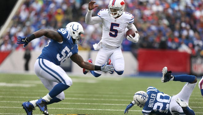Bills quarterback Tyrod Taylor escapes a tackle by Colts Darius Butler (20). Taylor ran for 41 yards in a 27-14 win.