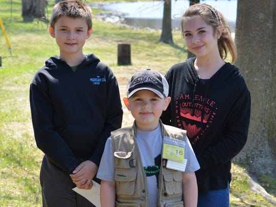 In the youth division, Daniel Neiderer, left, took first place, while Aiden McCleaf, center, and Alexa Dainton, right, tied for second.