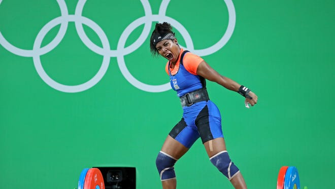 In this file photo the Marshall Islands' Mathlynn Sasser celebrates after a lift during women's weightlifting 58kg group B in the Rio 2016 Summer Olympic Games at Riocentro - Pavilion 2 on Aug. 8 in Rio de Janeiro, Brazil.