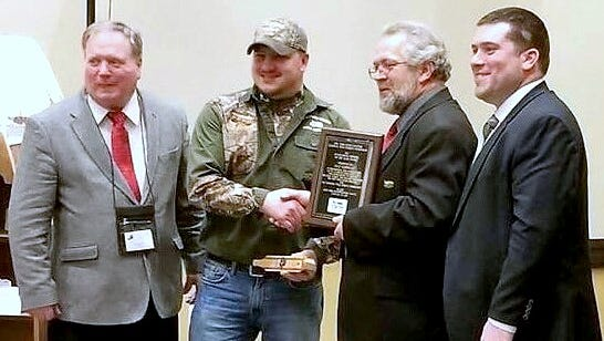 The National Wild Turkey Federation New York State Chapter recently honored Chad McDonald, president of the Chemung Valley Ridge Runners Chapter, with its Outstanding Member of the Year award. From left are Regional Director Marty Huber, McDonald, state chapter President Bill Wilbur, and Regional Director Sean Langevin.